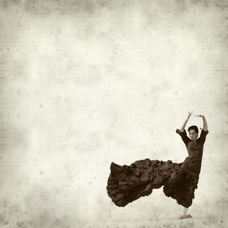 textured old paper background with flamenco dancer