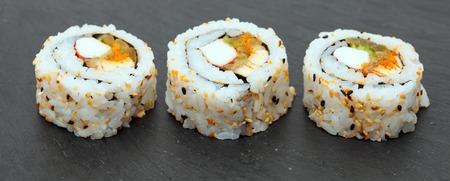 trivet: futomaki sushi rolls on a black slate trivet