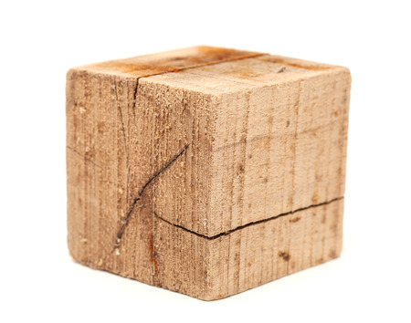 beachcombing: dirty and cracked wood cube, driftwood, isolated on white Stock Photo