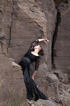 svelte: Flameco dancer in a basalt ravine, the rocks reachly textured