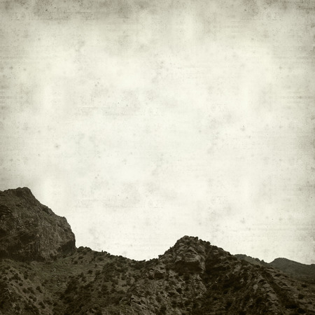 vallehermoso: textured old paper background with La Gomera landscape