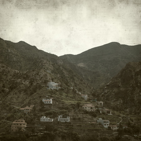 vallehermoso: textured old paper background with La Gomera landscape
