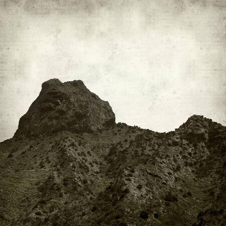 cano: textured old paper background with La Gomera landscape