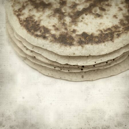 textured old paper background with stacked pancakes photo