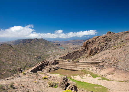 canary isalnds: Gran Canaria, Barranco de Soria, empty water reservoir on the wall of the valley