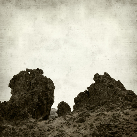 jose: textured old paper background with ladscape of Gran Canaria, Roque San Jose Stock Photo
