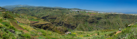 Gran Canaria, inland northern parts, panoramic view over Barranco de Azuaje from Firgas towards Moya, Tenerife in far distance Imagens