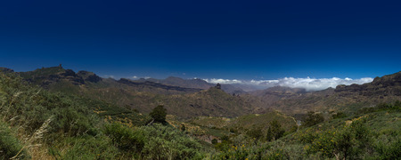 blanketed: Gran Canaria, Caldera de Tejeda in May, Altavista mountain range is covered by mountains Stock Photo