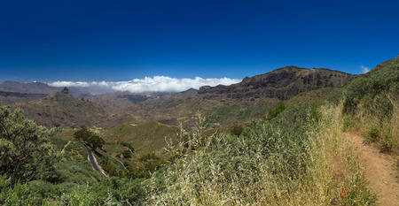 blanketed: Gran Canaria, Caldera de Tejeda in May, Altavista mountain range is covered by clouds, hiking path Stock Photo