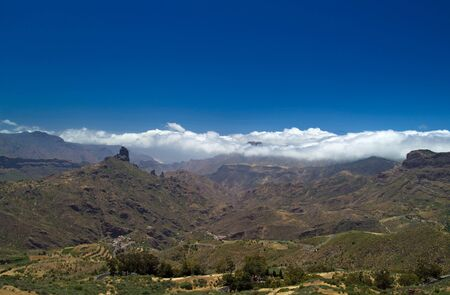 blanketed: Gran Canaria, Caldera de Tejeda in May, Altavista mountain range is covered by clouds, Teide on Tenerife visible on the right
