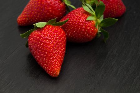 trivet: red ripe strawberries on a black slate stone trivet