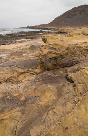 naturist: Gran Canaria, El Confital beach at the edge of Las Palmas, eroded sandstone patterns