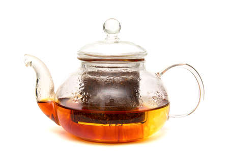 red bush tea: Rooibos tea being brewed in a small glass teapot, isolated on white Stock Photo