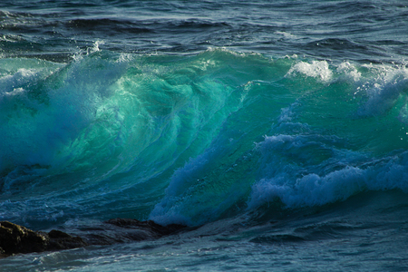 breaking waves: powerful ocean breaking waves with backlight, making the water translucent