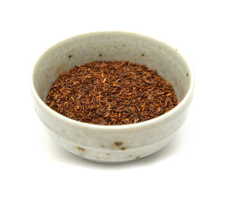 red bush tea: Rooibos tea, dry fermented  leaves isolated on white background