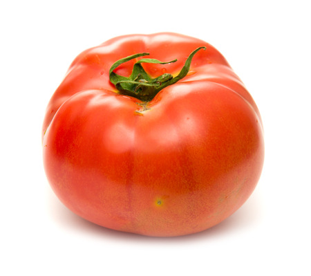 lycopene: large ground-grown tomato isolated on white background