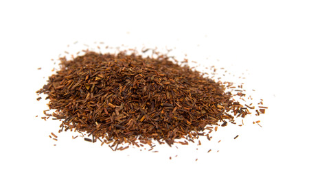 Rooibos tea, dry fermented  leaves isolated on white background