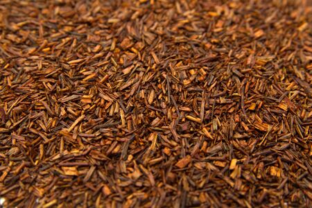 red bush tea: Fermented Rooibos or redbush tea leaves background