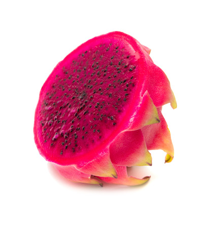 cut red dragon fruit with green scales isolated on white photo