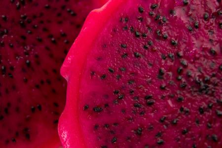 black seeds: cut red dragon fruit with black seeds food background Stock Photo