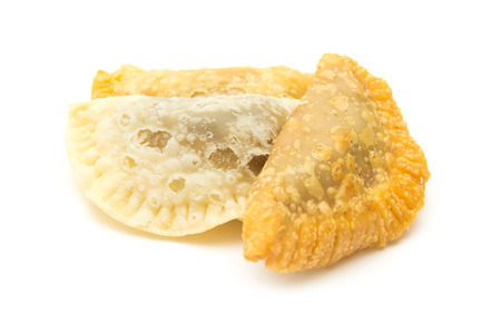 thin shell: Canary islands sweets - truchas de fruta. Trucha is literally a trout, which refers to fish-like shape of the pastry, traditionally filled with sweet potato, but with possible variations, here filled with summer fruit Stock Photo