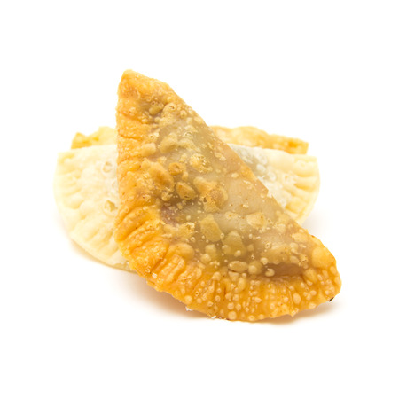 traditionally: Canary islands sweets - truchas de fruta. Trucha is literally a trout, which refers to fish-like shape of the pastry, traditionally filled with sweet potato, but with possible variations, here filled with summer fruit Stock Photo