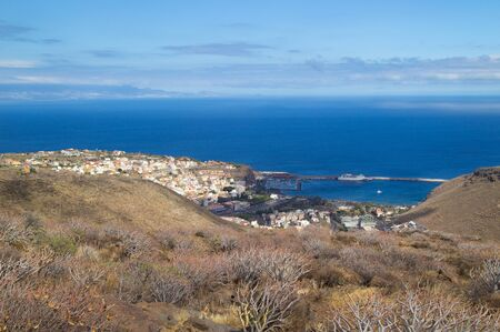 hillwalking: La Gomera, Canary islands, main town San Sebastian de La Gomera, as seen from low mountains to its west, south west coast of Tenerife on the horizon to the left