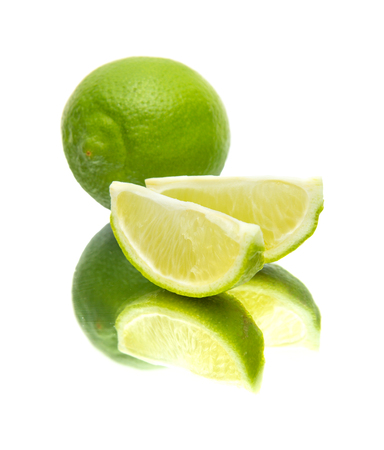 quartered: lime on mirror, isolated on white background