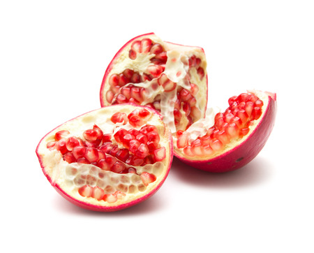segments: pomegranate segments isolated on white background Stock Photo