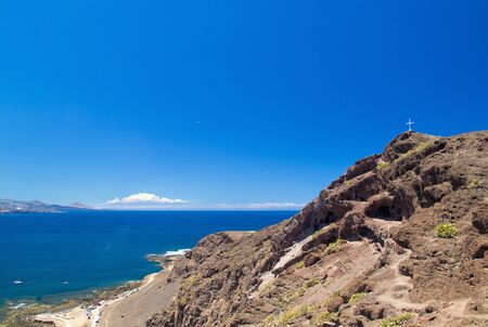 aborigin: a group of caves La Cueva de los Canarios above El Confital Beach, aboriginal dwellings, Gran Canaria