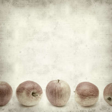 harvest background: textured old paper background with apples