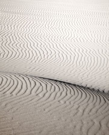 ridge of wave: sand and wind pattern on dune surface natural background Stock Photo