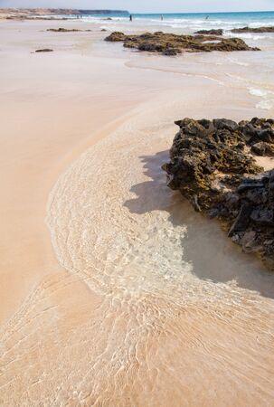 claen: Fuerteventura, Canary Islands, Playa del Castillo next to El Cotillo village, wave pattern Stock Photo