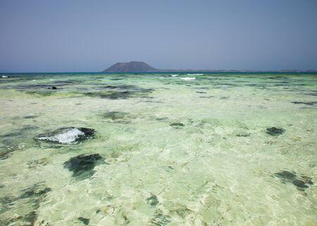 foaming: Nortern Fuerteventura, Corralejo Flag beach, Isla de LObos in the background
