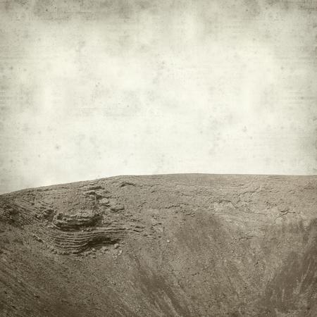 hondo: textured old paper background with Fuerteventura landscape, Calderon Hodo Stock Photo