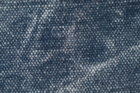 faded: old faded denim colored canvas textile background