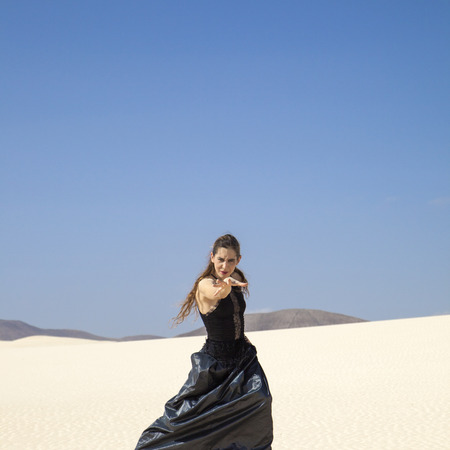 flamenco dress: young attractive woman in black flamenco dress  in dunes