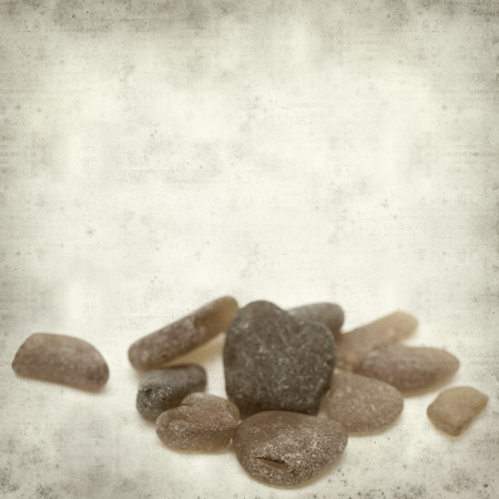 beachcombing: textured old paper background with sea glass pieces Stock Photo
