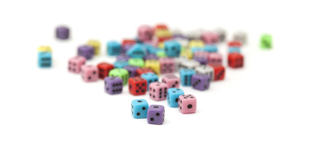 normal distribution: many small colorful plastic  dice isolated on white background