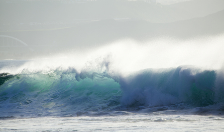 kinetic energy: powerful ocean waves breaking by El Confital Beach, Las Palmas de Gran Canaria