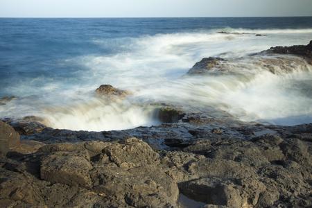 pressured: Ocean water rushes into undersea cave openings at Burafedo de La Garita, Gran Canaria