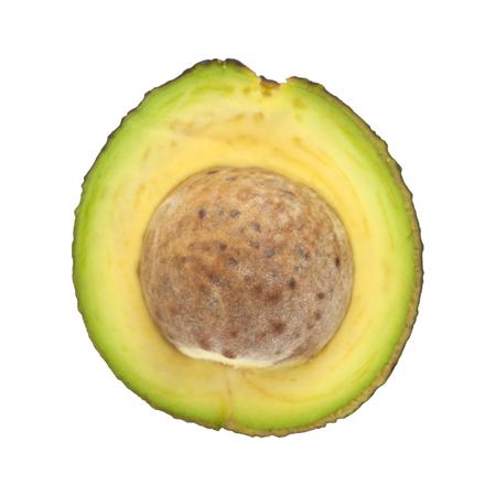 dark skinned: halved round dark skinned avocado pear isolated on white background