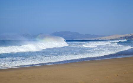 windward: Fuerteventura, Canary Islands,  wide seep of Cofete beach on Jandia Peninsula, rainbow foam on the waves