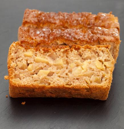 trivet: freshly made apple loaf cake, on a slate trivet