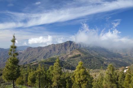north window arch: Gran Canaria, Caldera de Tejeda in February, Clouds rolling into caldera from the north Stock Photo
