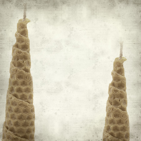 beeswax candle: textured old paper background with wrapped beeswax candle