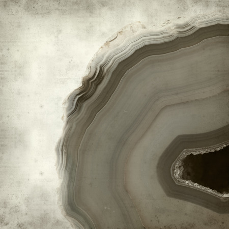 spot the difference: textured old paper background with agate stone