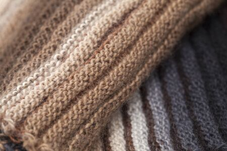 purl: two-sided ribbed knitted scarf, gradua color change, craft background