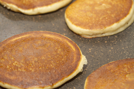 griddle: making thick pancakes on dry griddle surface Stock Photo