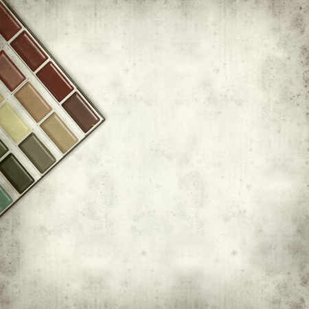 textured old paper background with watercolor paint set